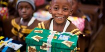 Broker Dealer Sends Gift Shoeboxes to Children